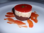 Dark chocolate biscuit, topped with wattle seed and white chocolate mousse with blood orange & cinnamon sauce.